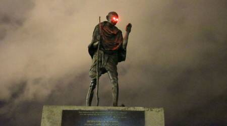 mahatma gandhi, gandhi statue san francisco, gandhi statue vandalised, gandhi statue red lights eyes, gandhi statute glowing red eyes, viral news, indian express