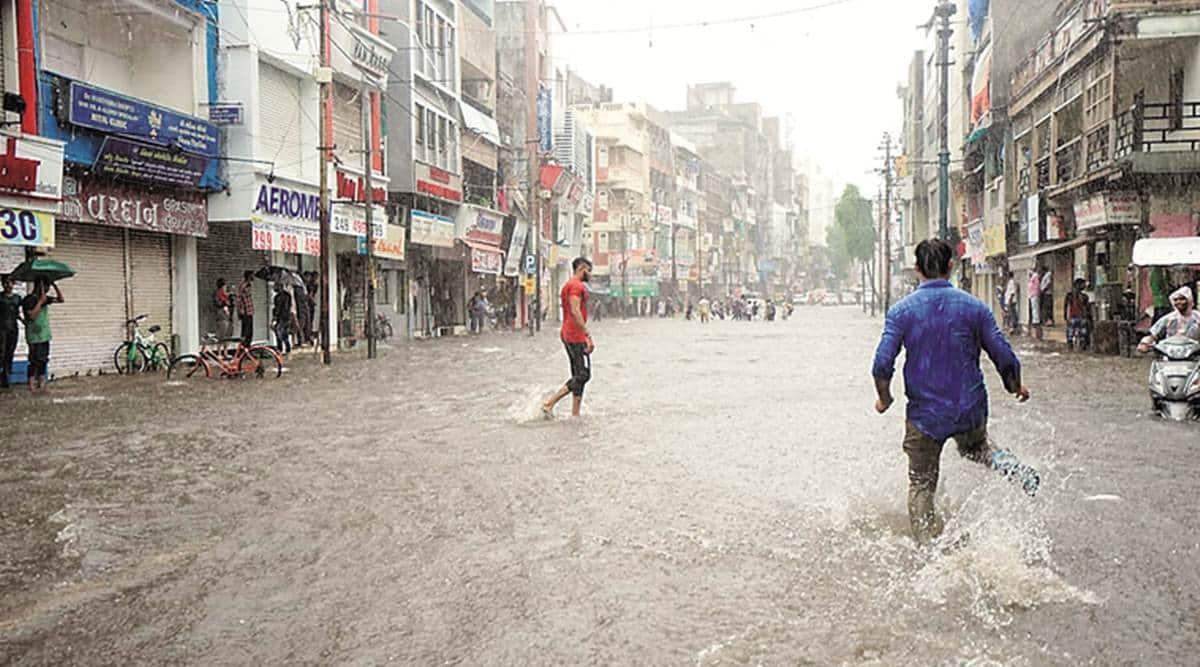 Gujarat rainfall, Workers rescued, Rajkot news, Ahmedabad news, Indian express news