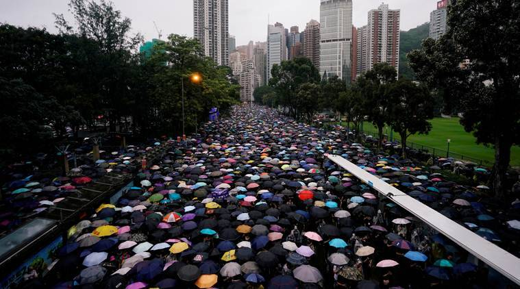 China pressures business over Hong Kong; workers get caught in the middle