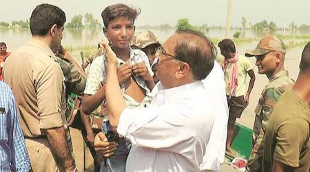 Punjab lawmakers join rescue teams in helping flood-hit villagers