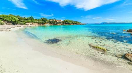 Couple fines, Sardinia beach, Indian Express
