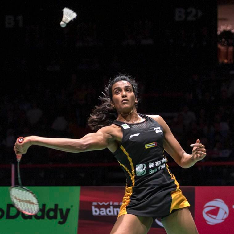 India's Pusarla V. Sindhu returns a shuttlecock to Japan's Nozomi Okuhara during their women's singles final match at the BWF Badminton World Championships in Basel, Switzerland, Sunday, Aug. 25, 2019. (Georgios Kefalas/Keystone via AP)