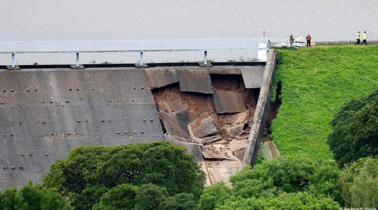 Northwest England town evacuation, Derbyshire Dam wall holding, England heavy rainfall, Europe heatwave, world news