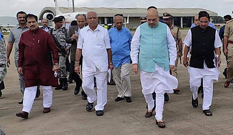 Union-home-minister-Amit-Shah-belgaum-airport-BS-Yediyurappa-Suresh-Angadi