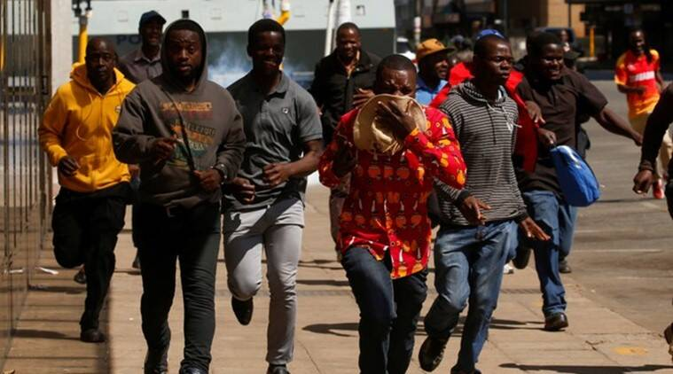 Zimbabwe police beat protesters as opposition denounces 'fascist' government