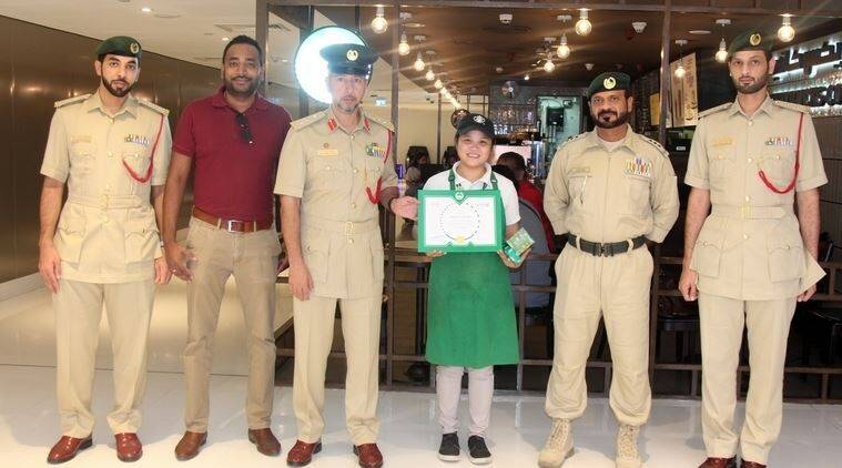 barista returns bag full of cash, starbucks employee return lost bag, dubai police honour barista return cash bag, indian express, good news