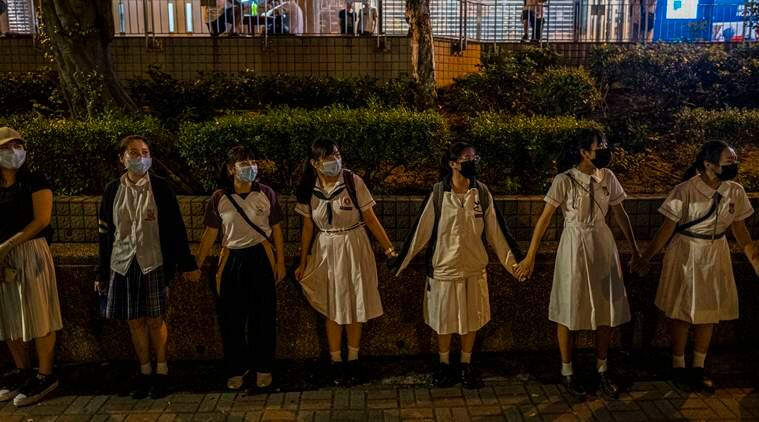 She's a Hong Kong protester. Her husband is a cop. It's complicated.