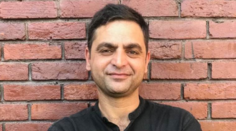 gowhar geelani, kashmiri journalist, kashmiri author, stopped from going to germany, indian express