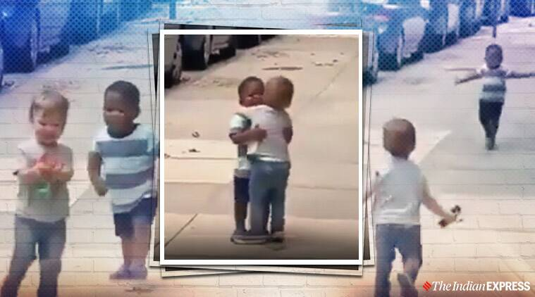 toddlers hugging on streets viral video, adorable video toddlers viral video,