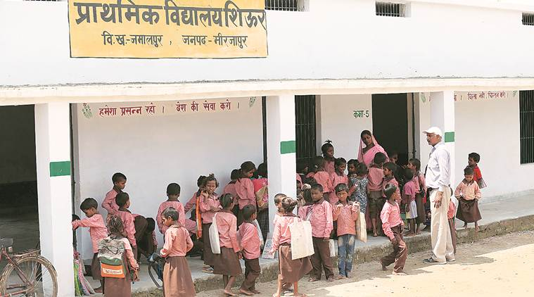 mid day meal, mirzapur mid day meal, mirzapur students video, students served roti and salt, pawan jaiswal, substandard mid-day meal, UP police, mid-day meal reporter, indian express