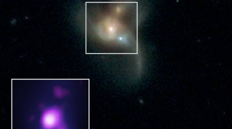 Three black holes on a collision course