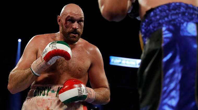 Tyson Fury overcomes bloody cut to beat Otto Wallin, sets up rematch with Deontay Wilder
