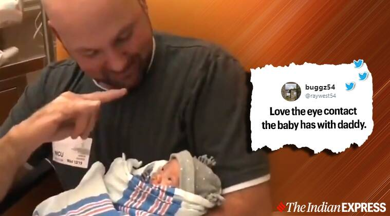 father signs with new born baby viral video, asl, sign language, deaf father signs with new born daughter, viral video, trending, indian express