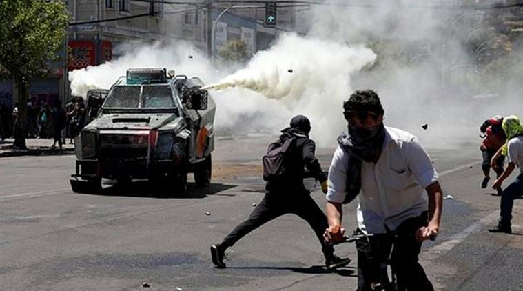 Chile cancels APEC trade meet, global climate summit as protests rage