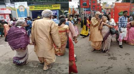 Old couple, Durga Puja, Old couple at Durga puja, elderly couple at Durga puja pandal, Old couple pandal hopping, Kolkata, Viral pictures, Trending, Indian Express news