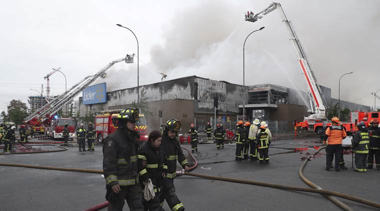 Three die after supermarket set on fire, flights out of Santiago delayed due to Chile riots