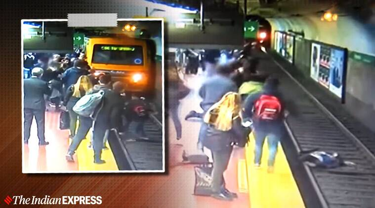 Man faints and accidentally knocks woman onto train tracks
