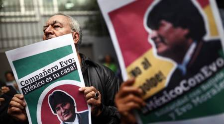 Bolivia's new leader seeks quick election, Morales says he could return