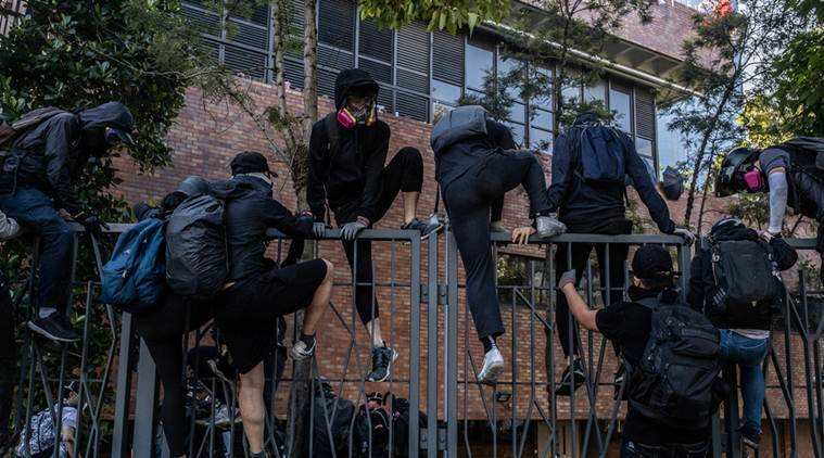Hong Kong protests: Demonstrators trapped at Polytechnic University as court overturns mask ban