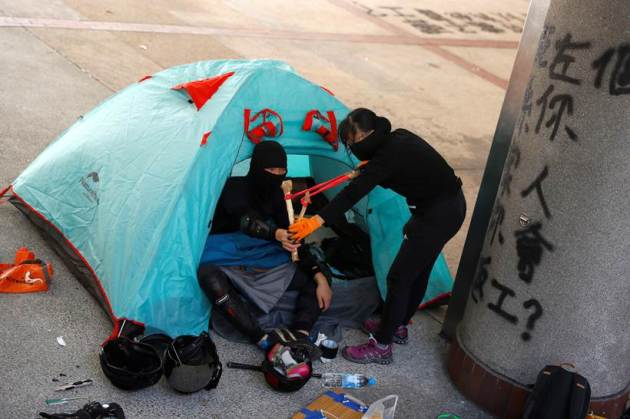 No end in sight to Hong Kong protests as students ready bows and arrows against police
