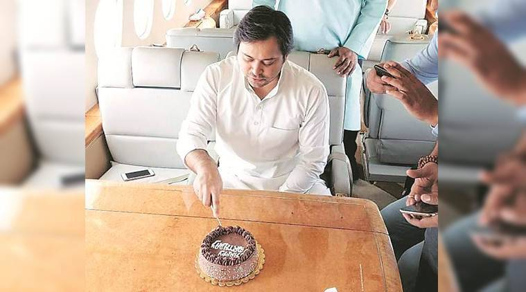 Jdu slams tejashwi yadav over birthday on flight
