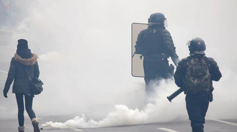 France: Tear gas fired as yellow vests attempt comeback