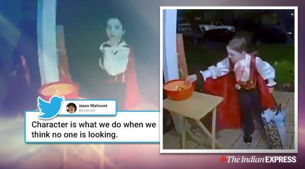 halloween, best halloween video, hallween 2019, trick or treat halloween, boy fills empty candy bowl, halloween best video, good news, indian express, viral videos
