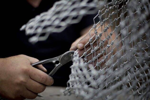 palestinian photographer haitham khateeb, Israeli-occupied West Bank, wire sculpting, recycling metal wire, world news, indian express