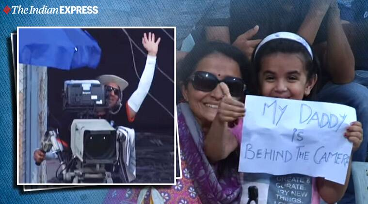 Girl's placard cheering for cameraman dad goes viral, girl cheers for dad during cricket match, T20 league match, Mumbai, Cricket, Trending, Indian Express news