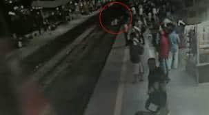 Watch   RPF jawan put his life at risk to save passenger at Thane station
