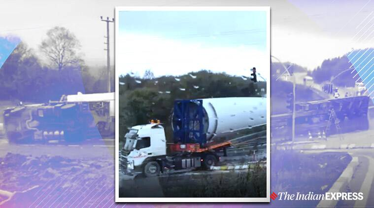 turbine blade carrying truck overturns, truck carrying blade topples, viral videos, turkey news, indian express