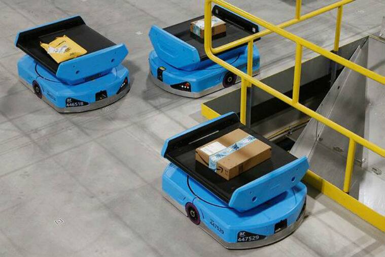 amazon robots, amazon workers, robot helping humans in their work, workers adapting to working with robots