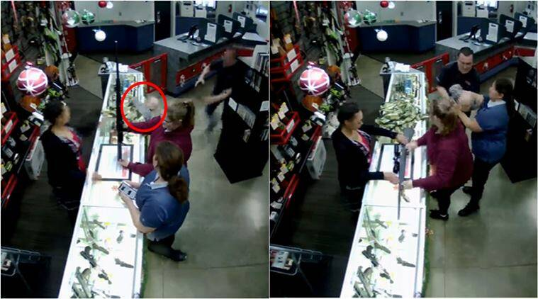 ball fall off glass counter, woman admire rifle baby fall off counter, store manager save baby falling counter, viral videos, indian express,