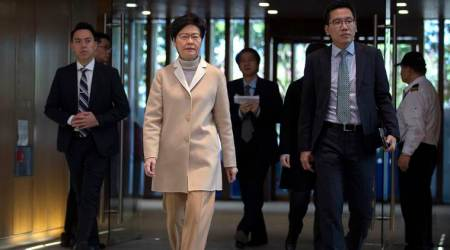 Hong Kong leader Carrie Lam heads for Beijing as pressure mounts at home