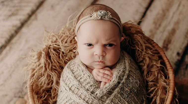 baby mean mug, mean mugging baby, grumpy newborn photoshoot, viral newborn photo shoot, viral news, indian express