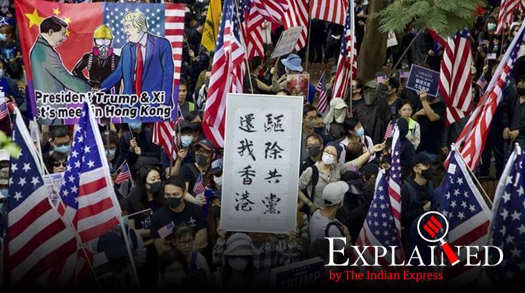Protesters hold banners and American flags during a rally outside the US Consulate in Hong Kong on December 1. (AP photo)