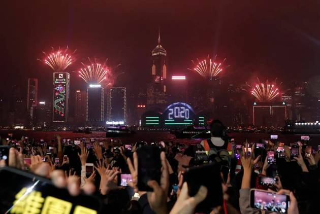 Cheers, tears, prayers for 2020: How new year is being ushered in across the world