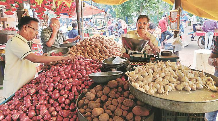 A night guard to protect onions at Surat market