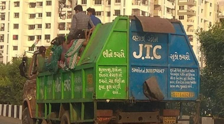 Surat photo goes viral: Contractor ferries labourers in garbage vehicle, faces probe