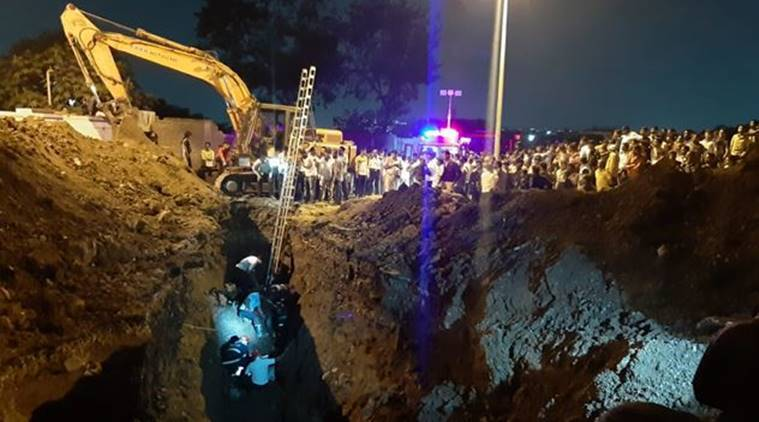 Labourer firemen trapped in trench in Pune, Pune accident, Dapodi accident, Phugewadi flyover, Pimpri Chinchwad fire brigade, Pune news, indian express