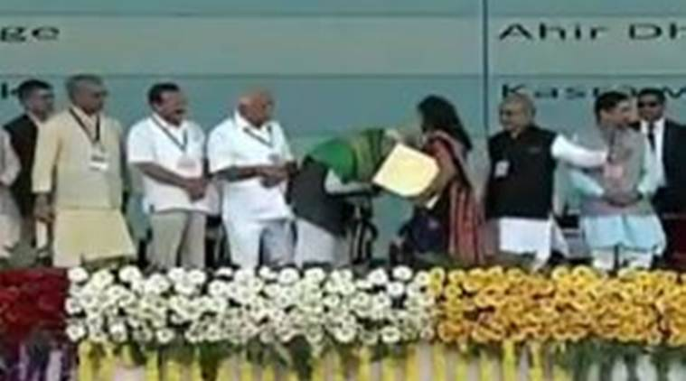 WATCH: PM Modi stops woman from touching his feet, touches hers instead