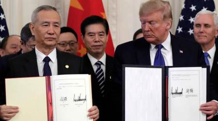 US signs first phase of trade deal with China