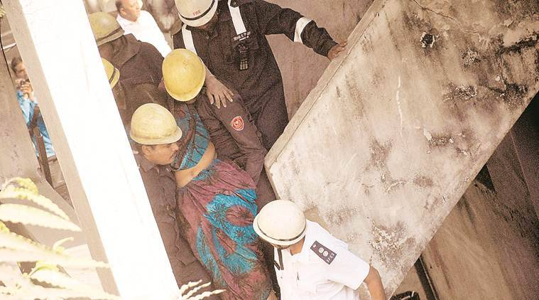 surat building collapse, workers rescued, injured in building collapse, surat news, indian express news