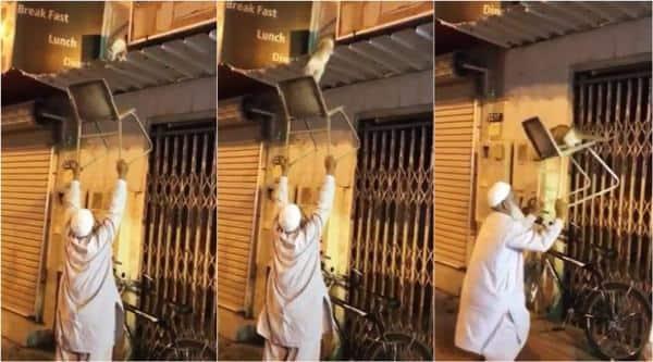 man saves cat, chachaji saves cat, elderly man rescues cat, cat rescue, man rescue cat with chair, viral videos, animal rescue videos, indian express