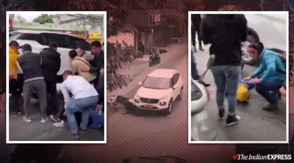 Strangers help road accident, Passersby lift car after accident, Road accident video, China accident, Lift car to rescue trapped biker, Viral videos, Good news, Indian Express