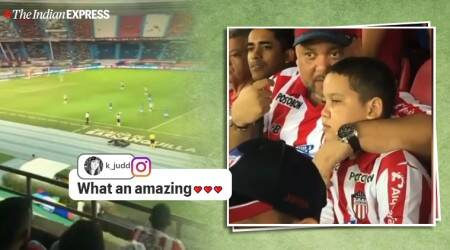 Colombian junior FC, junior fc dad relays match blind son, dad explain football match blind son, viral father son video, indian express, sports news, viral videos