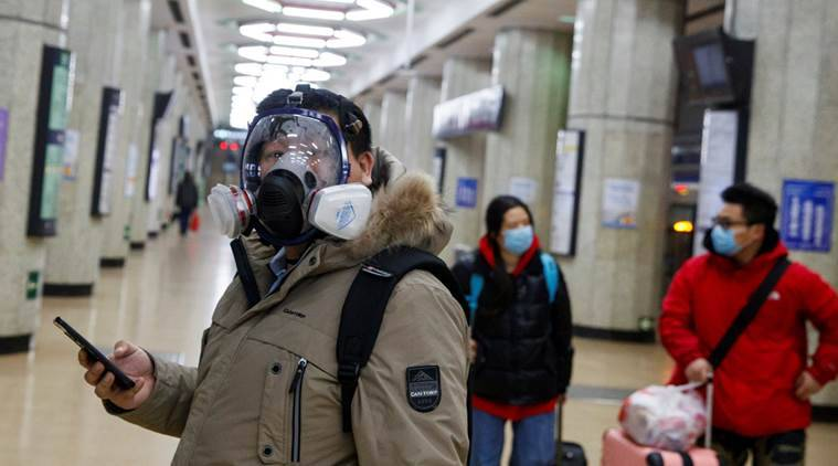 A man wears a face mask at a metro station in Beijing