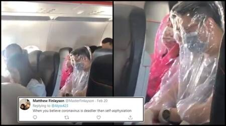 Coronavirus, Coronavirus in Australia, Coronavirus precaution, Airline passenger Coronavirus precaution, Airline passengers in plastic bodysuit, Plastic makeshift bodysuit, Coronavirus precaution on aeroplane, Trending, Indian Express news