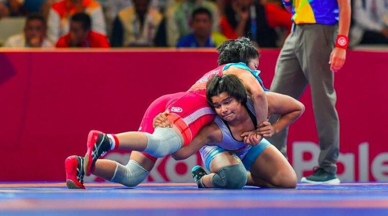 Divya kakran humbles junior world champion to win asian wrestling championships gold