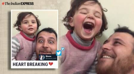 syrian father daughter laughing game, syrian man teach kid to laugh at airstrike, bomb sound laughing game father kid, syrian war, idlib, idlib airstrikes, syrian airstrikes, viral videos, indian express